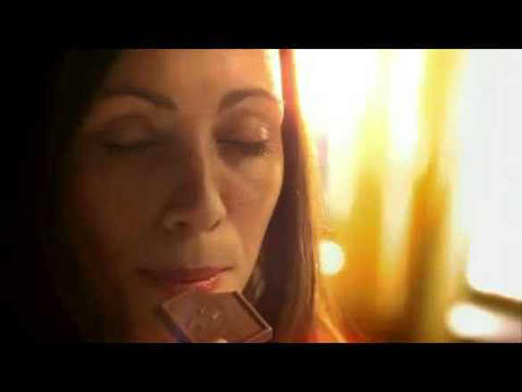 Woman biting chocolate