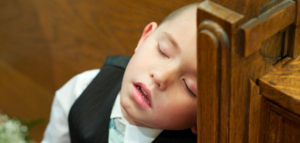 Child sleeping in church