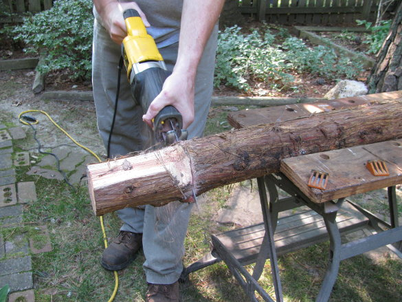 cutting a log