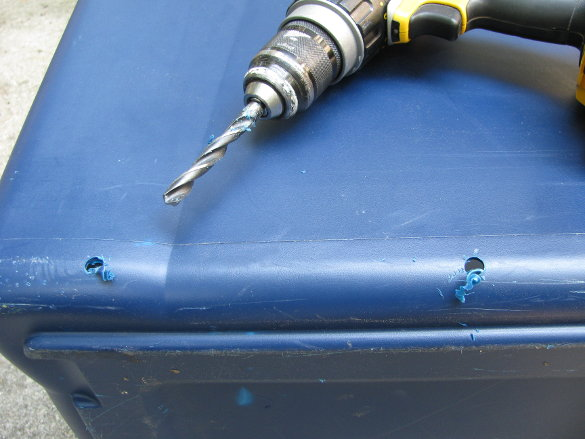 Drilling holes in plastic bin